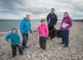 Picture: L to R - Ewan Moxon (volunteer) Richard Lochhead Ellie Moxon, Calum Brown (Head of Conservation Scotland at Marine Conservation Society and mum Alicia Moxon.
