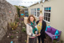 Picture by JASON HEDGES    25/09/2018 - Pictures show the newly finished garden space at the Children First charity premises in Elgin.  Picture:L2R - Lindsay Fovargue (Service Manager) and Jackie Hector (Family Support Worker) who also completed most of the gardening.