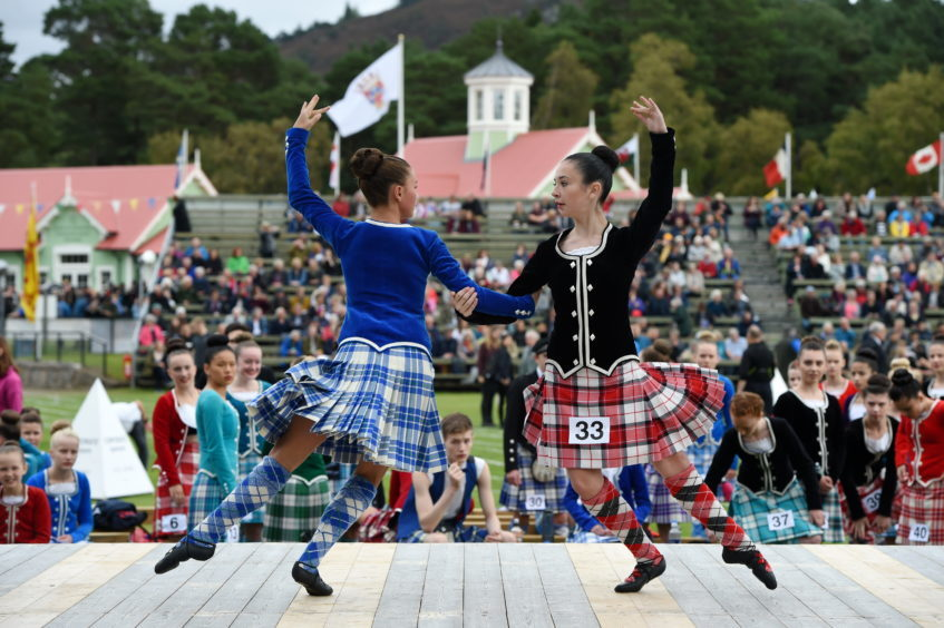 Braemar Gathering 2018, at The Princess Royal and Duke of Fife Memorial Park in Braemar. Picture of Highland Dancing, Rosey Watt, 14, and Emma Smart, 13.  Picture by KENNY ELRICK     01/09/2018