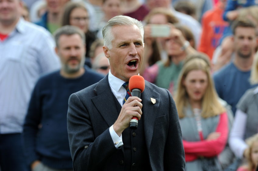 Braemar Gathering 2018, at The Princess Royal and Duke of Fife Memorial Park in Braemar. Picture of Robert Lovie singing.  Picture by KENNY ELRICK     01/09/2018