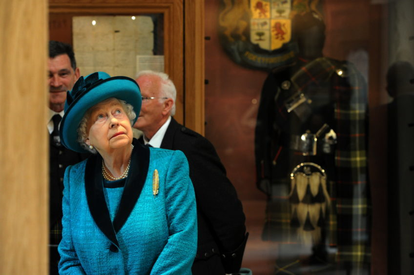 Braemar Gathering 2018, at The Princess Royal and Duke of Fife Memorial Park in Braemar. The Queen has officially opened a new Highland Games centre - named after her son the Duke of Rothesay. Picture of the Queen looking around the new pavilion.  Picture by KENNY ELRICK     01/09/2018