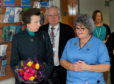 Staff nurse Linda Watt showing Princess Anne around the wards.
