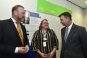 DWP Minister Guy Opperman (R) talks to senior operations manager Suzanne Mann and MP David Dugui on his visit to Banff job centre.