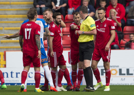 Mikey Devlin was sent off for a foul on Eamonn Brophy against Kilmarnock.