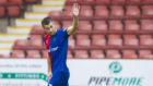 Liam Polworth salutes the away supporters after scoring Caley Thistle's second against Dunfermline.