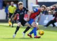 Inverness's Sean Welsh holding off Ross Countys Michael Gardyne.