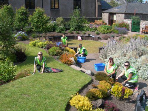 Volunteers help prepare for the Brighter Bervie judging day - photo Brighter Bervie