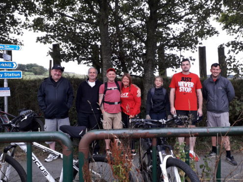 David Bruce, second from the left, with his friends before starting their cycle