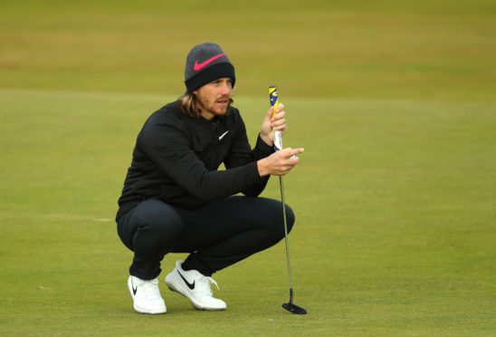 Tommy Fleetwood of England lines up a putt in his final round at St Andrews