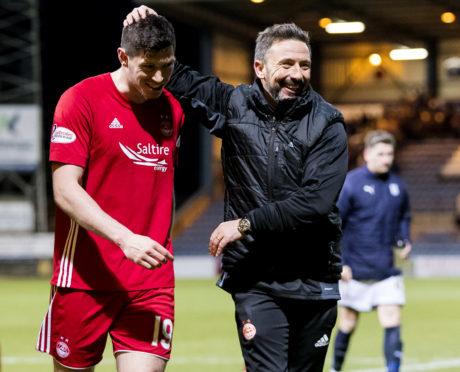 Scott McKenna will help manager Derek McInnes by returning from suspension against Rangers.