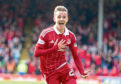 Aberdeen's James Maddison celebrates scoring at the Pittodrie.