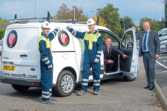 NES Electrical Firm Targets Surge Growth Drew Hendry MP with Kenny Duncan, NES managing director with  Apprentices  Tyler Whitty (17) and Kyle Livingstone (18  Picture by Trevor Martin.