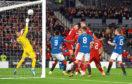 Fergie time: The Dons midfielder heads home the winner against Rangers.