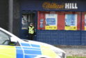 The William Hill shop on Summerhill Court was raided by two masked robbers. Photo: Joanne Warnock