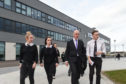 Deputy First Minister John Swinney is guided round Elgin High School by students Tilly Stewart, Abigail Isaacs and Fraser Duncan.