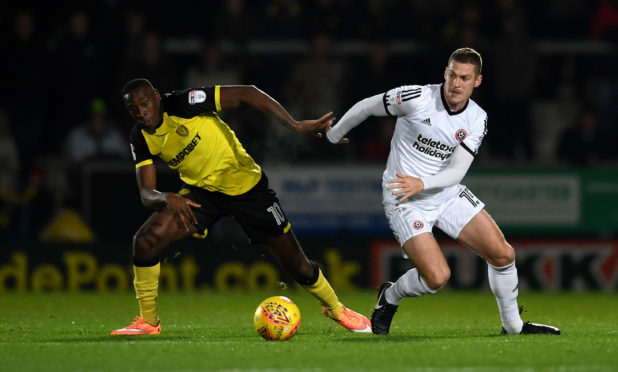 Paul Coutts in action against Burton Albion in the game he broke his leg.