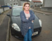 """Kat Reid has been told ber car is both """"fine"""" and """"not roadworthy""""."""