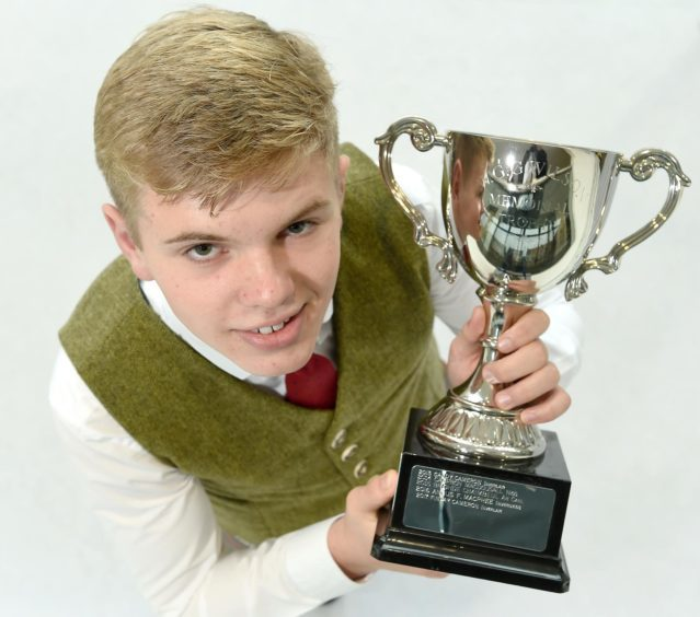 Gregor Macdonald of Oban High School with the WGG Wilson Trophy for Piobaireachd in the under 19 age category.