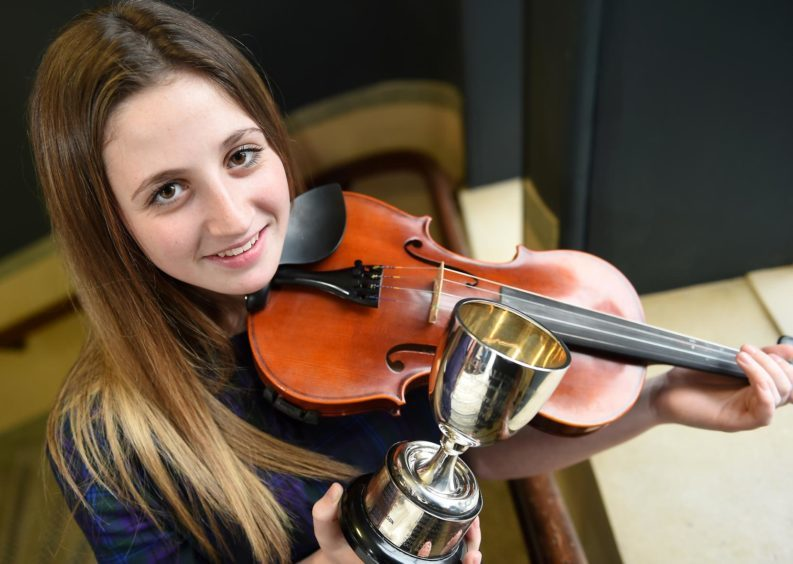Abbie Morris from Port Ellen, Islay, winner of the Robert MacCallum Memorial Trophy for playing a Slow Gaelic Air and March, Strathspey and Reel in the 13 - 18 age category.