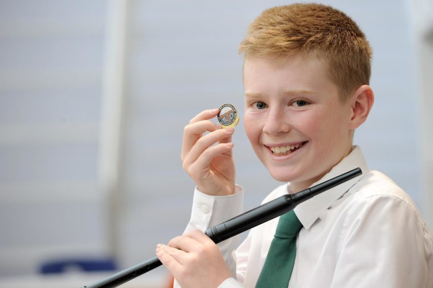 Joe MacPherson of Fife, winner of the Chanter competition playing a Gaelic Air in the under 13 age group despite hurting his shoulder recently while playing badminton.