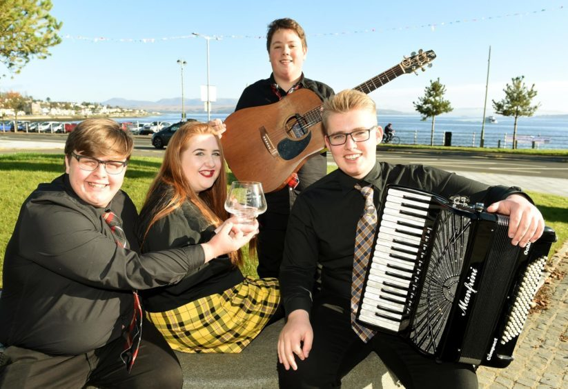 The Aberdeen Music School, winners of the Allan Thomas Mitchell Trophy for Folk Groups. Guitarist Arthur Coates, Accordionist Duncan Ritchie, Stuart Jack and Elizabeth MacKenzie.