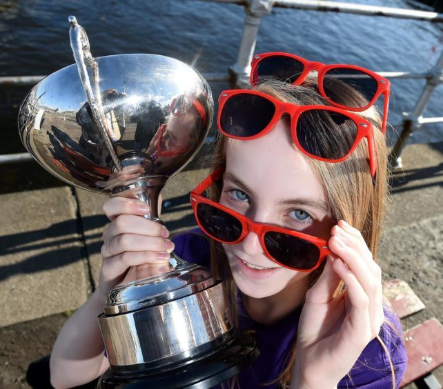 Enjoying the sunshine after all the rain over the weekend, Lauren Morris of Bowmore Primary School, Islay with The Cowal Trophy for the recitation of prescribed poetry.