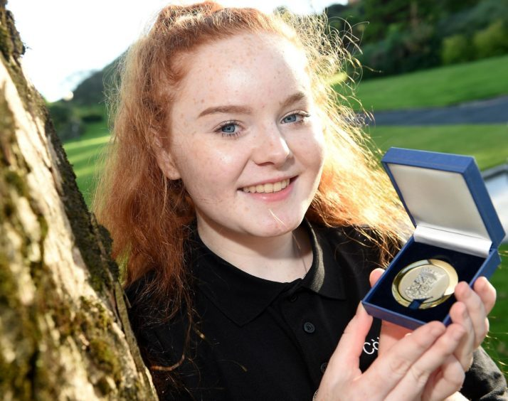 Rachel Bolton of Lochaline with the Provost of Falkirk Medal for Singing in Traditional Style in the 16-18 age category.