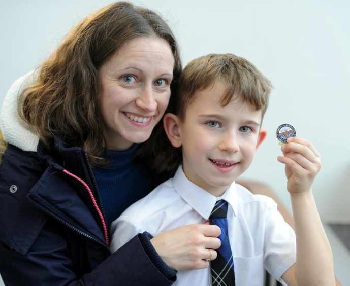 Calvin Fraser of Condorrat Primary School with mum Alison and his Gold Badge for singing a prescribed song in the under 7 age group.