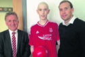 James Stewart, centre, with Aberdeen FC vice chairman George Yule and Russell Anderson.