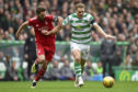 Aberdeen's Graeme Shinnie chases down Celtic's James Forrest