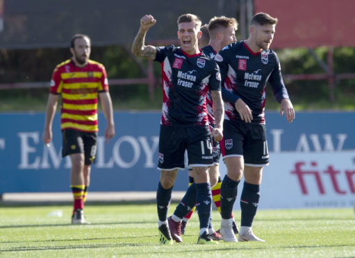 Josh Mullin celebrates opening the scoring for Ross County.