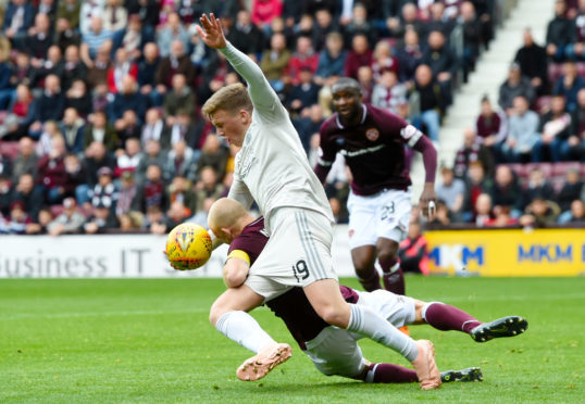 Lewis Ferguson was adjudged to have fouled Steven Naismith for Hearts' first penalty.