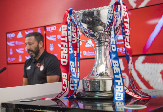 Aberdeen manager Derek McInnes with the Betfred Cup yesterday.
