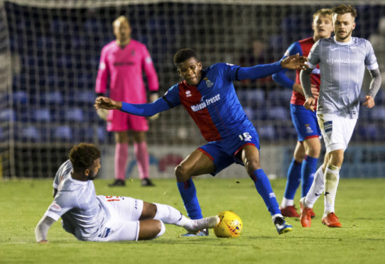 Riccardo Calder (right) is tackled by Myles Hippolyte