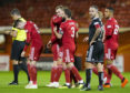 James Wilson is congratulated after scoring from 30 yards.