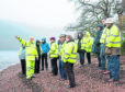 Planning Officer Ken McCorquodale addresses the committee on the shores of Loch Lochy.