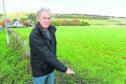 Fortrose Community Council Chairman, Tom Heath beside the field on the outskirts of Fortrose.
