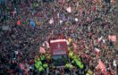 Aberdeen FC parade the Scottish League Cup trophy through the city centre after their 2014 triumph.