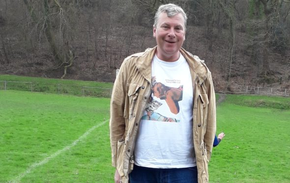 Football fan Mark Jones with his dog Bear at a friendly in Fort William earlier this year.