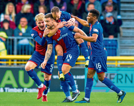 George Oakley (centre) celebrates his equaliser for Inverness.