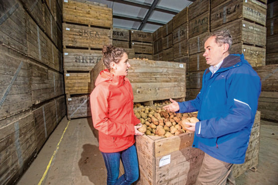 Rural Affairs Minister Mairi Gougeon with Andrrew Skea on a visit to Skea Organics at East Mains Farm, Dundee.