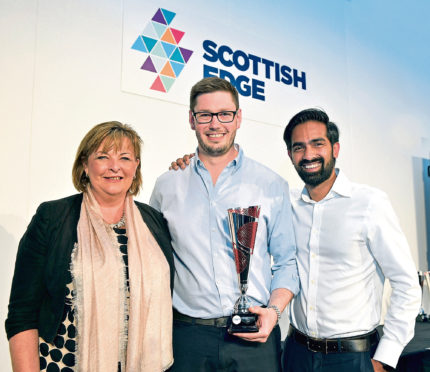 Scottish EDGE winners Douglas Martin and Shreekanth Ramanthan of MiAlgae with Fiona Hyslop MSP.