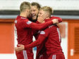 Gary Mackay-Steven of Aberdeen celebrates after scoring opening goal with Stevie May and Niall McGinn of Aberdeen.