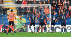 Dundee United's Paul Watson opens the scoring.