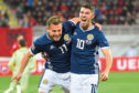 Scotland's Ryan Fraser (L) celebrates his goal with teammate Ryan Christie.