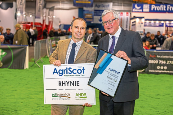 Donald Ross receives his award from Rural Economy Secretary Fergus Ewing.