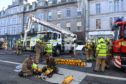 Fire crews at work outside the blaze at Amarone, Union Street, on Saturday.