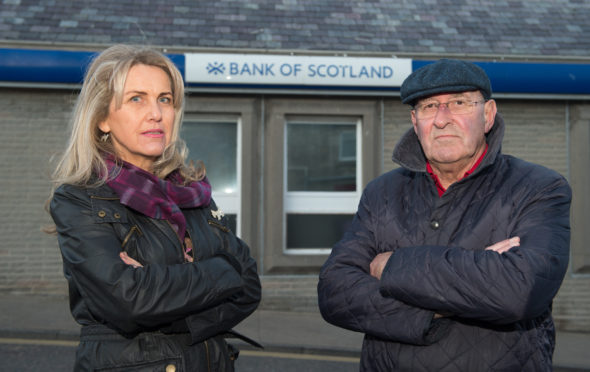 Lossiemouth Community Council vice-chairwoman Carolle Ralph and chairman Mike Mulholland outside the town's Bank of Scotland branch.