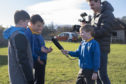 Charlie Kennedy interviews his classmates at Aberlour Primary School.