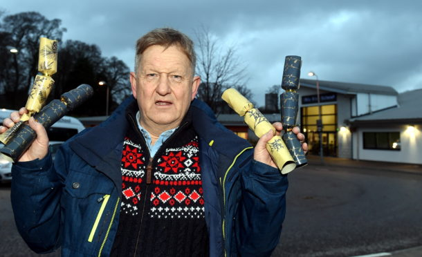 Councillor Alex Nicoll has been left unimpressed by the council's decision not to hand out crackers at school Christmas dinners.